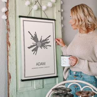 girl holding poster hanging from door